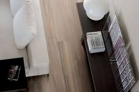 3of 19this room shows casa dolce casa s wooden tile in walnut it s porcelain tile that es in planks and looks like wood photo thorntree slate marble