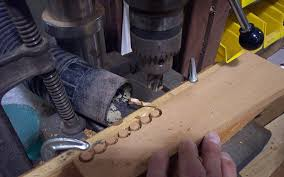 set the drill to leave about 1 16 inch uncut at the base of the plugs