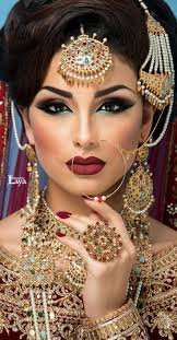modern 4 the makeup artist here has taken into account all of the brides colours the blue under the eye is striking next to the red of the lips the