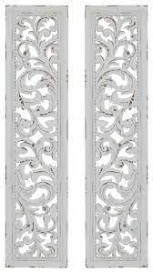 tall distressed white carved wood wall