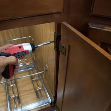 removing hinges from kitchen cabinet door in advance of instaling a door mount trashcan