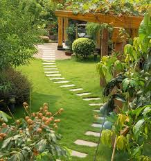 backyard gardens. The Winding Stone Path Provides A Lovely Way To Enjoy This Garden That Features Stunning Backyard Gardens S