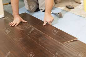... Synthetic Wood Flooring Projects Idea Man Installing New Laminate Wood  Flooring Abstract Stock Photo ...