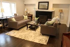 pair of modern sofas around fireplace