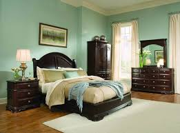 blue paint colors for bedroom with dark furniture and hardwood floors cozy paint color for