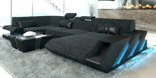 nevio leather fabric power reclining sectional sofa with articulating headrests collection jedd gray sectiona