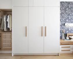 modern white closet doors. clean white wardrobe with wooden handles   closet board pinterest wardrobe, bedrooms and bedroom closets modern doors l