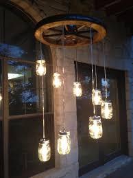 cottage mason jar chandelier. Spiral Wagon Wheel Mason Jar Chandelier Small By RusticChandeliers Cottage