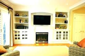 tv placement in small living room with fireplace furniture arrangement in living