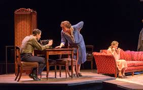 "breathing new life into an american classic here now from left zachary quinto as tom cherry jones as amanda and celia keenan bolger as laura are pictured in a scene from the a r t s ""the glass menagerie"