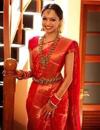 love the rbandh the jhumkas the necklace the red sari and even the simple makeup