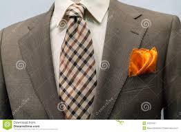Light Orange Blazer Jacket With Brown Checkered Tie And Orange Handker Stock