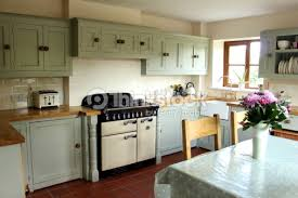 Traditional country kitchen, gas range cooker, wooden worktops, table,  chairs