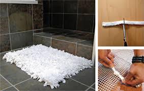 my rag rug odyssey began with this simple diy eco friendly bath mat i ran across at curbly com