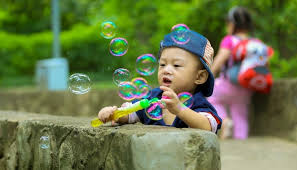 Three year old boy blowing bubbles with one of the best toys for 3 Best Toys For Year Old Boys 2019 \u2022 Toy Review Experts