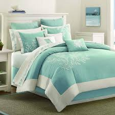 light blue teal c pattern bed forter with beach