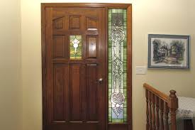 stained glass sidelight and front door window with bevels