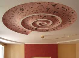 swirl ceiling design with pink wallpaper