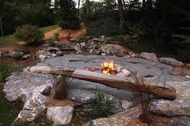 natural patio with firepit and bench