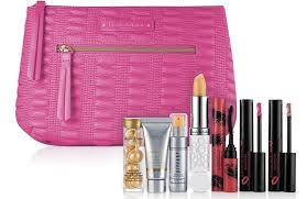 grand entrance maa and beautiful color bold liquid lipstick in luscious raspberry or daring beige all inside a beautiful pink makeup bag