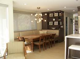 banquitos de troncos dining room contemporary with built in shelves beige upholstered chair wood dining