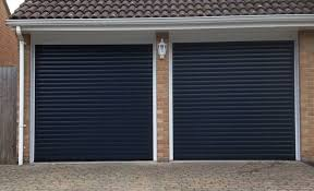 roller doors roller shutters electric doors automated doors this style goes by many names and is fast catching up on the up over canopy door to become