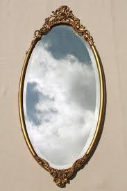 antique vintage beveled glass mirror w ornate old gold metal oval frame