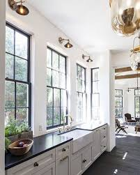 White kitchen with black steel windows | See this Instagram photo by ...