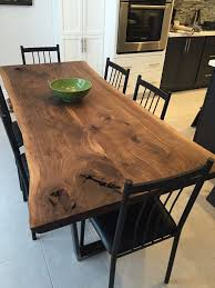 nice black walnut dining table with tzoid legs