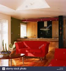 Living Room With Red Sofa Red Sofa In Modern Open Plan Living Room And Kitchen Extension