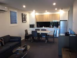 avenue hotel canberra living room towards well equipped kitchen