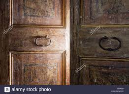 old wooden door opening with light shining through stock image