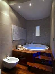 master bathroom with built in blue lights in the wooden steps