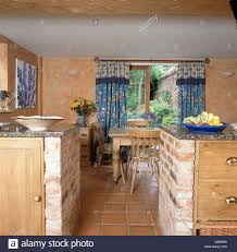 Brick Kitchen Floors Granite Worktops And Pine Drawers On Brick Units In Country