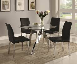 sleek round glass dining tables that make a stylish impression discover the season s newest designs