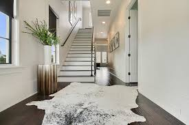cow hide rugs staircase contemporary with animal rug black intended for ideas 6