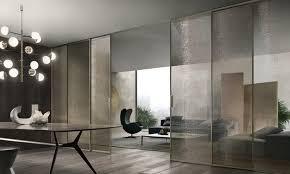 velaria sliding doors in palladio aluminum and golden mesh glass
