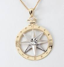 14k yellow gold and rhodium compass rose pendant