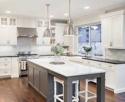 Beautiful White And Gray Kitchen With Island.