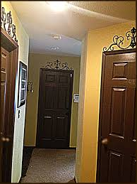 espresso brown doors through our my house matching baseboards and trim home sweet home diy dark brown interior doors iron accents on top of all doors