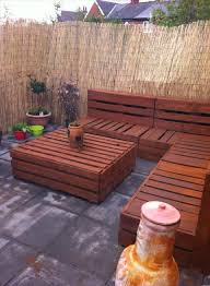 pallet furniture garden. Pallet Corner Settee For Your Reed Fenced #Garden - Spectacular Patio Furniture Ideas | Garden G
