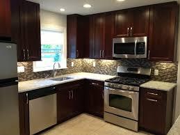 Dark Kitchen Cabinets With Light Floors Glass Stainless Steel Hanging Rang  Hood Beige Wooden Laminate Flooring