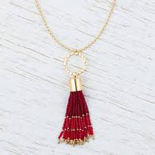 gold plated pendant necklace with red glass beads red