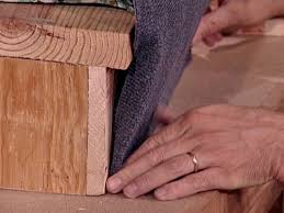 carpet on stairs. push carpet onto tackless strip with awl on stairs