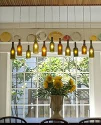 chandelier of utilized old wine bottles to create unique lighting fixtures on her dining room ceiling