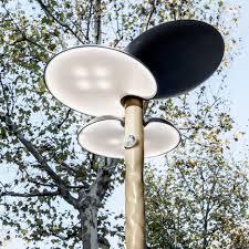 mathieu lehanneur designs solar powered clover street furniture for paris