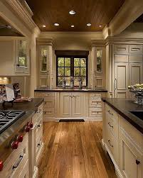 Love! cream cabinets, dark counters and knobs, oak floors and the wood  ceiling