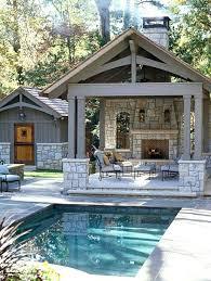 outdoor patio fireplace lit backyard plans paver stone