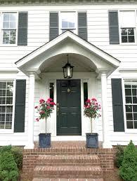 front door styling and accessory ideas colonial house topiaries planters br door knocker black door etc