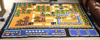 one man rules the mushroom kingdom with a crocheted super mario bros 3 map